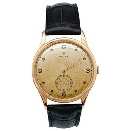 Rolex-Montre Rolex en or rose, bracelet cuir.-Autre