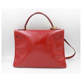 Hermès-Vintage Hermès Kelly 32 em couro vermelho-Vermelho