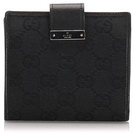 Gucci-Portefeuille à deux volets en toile GG noir Gucci-Noir