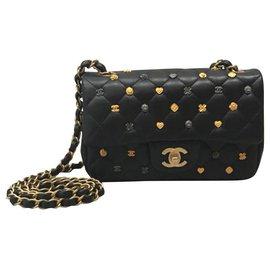 Chanel-Sac à rabat Chanel mini porte-bonheur en édition limitée.-Noir
