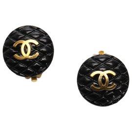 Chanel-Boucles d'oreilles clip matelassées Chanel CC noir-Noir,Doré