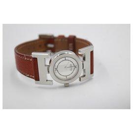 Hermès-Montre Hermès Paprika avec bracelet en cuir marron.-Marron