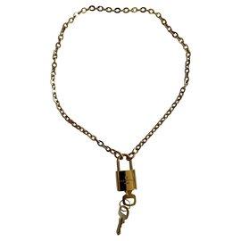 Louis Vuitton-Purses, wallets, cases-Golden