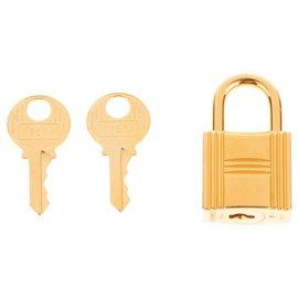 Hermès-Cadenas Hermès doré pour sacs Birkin ou kelly, état neuf avec 2 clés et pochon d'origine!-Doré