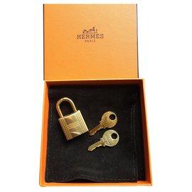 Hermès-Cadenas Hermès doré pour sac a main Birkin ou Kelly Neuf-Doré