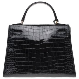 Hermès-Splendid Hermès Kelly 28 in black Porosus Crocodile, gold plated metal trim, in superb condition!-Black