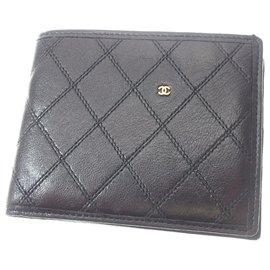 Chanel-Petit portefeuille en cuir matelassé noir Chanel-Noir