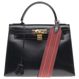 Hermès-Superb Hermès Kelly saddler 32cm black box leather, shoulder strap in red and black strap, gold plated metal trim, In very beautiful condition!-Black