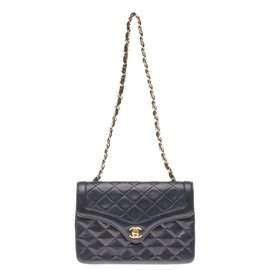 Chanel-Splendid classic Chanel Mini bag in navy blue quilted leather, garniture en métal doré-Navy blue