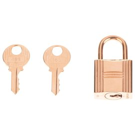 Hermès-Hermes, Hermès padlock in golden metal for Birkin bags, Kelly, new condition with 2 keys and original pouch!-Golden