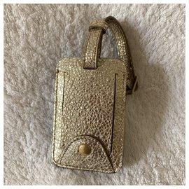 Yves Saint Laurent-Étiquette de voyage en cuir doré-Doré