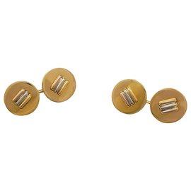 Cartier-Cartier three-gold cufflinks.-Other