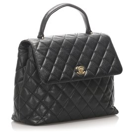 Chanel-Sac à main en cuir noir Kelly Caviar Chanel-Noir