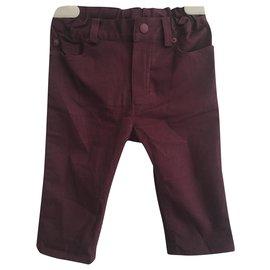 Christian Dior-Un pantalon-Bordeaux