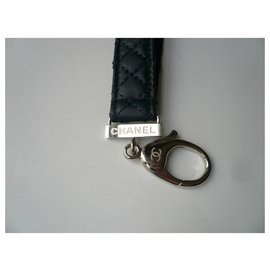 Chanel-CHANEL New quilted blue leather keychain with pouch and original box-Dark blue