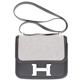 Hermès-Limited Edition / New / Hermès Constance 24 bi-material in beige canvas and black leather, New condition, full st!-Black,Beige