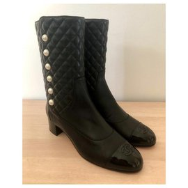 Chanel-Chanel boots in black leather-Black