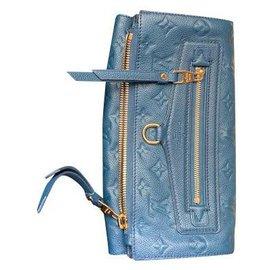 Louis Vuitton-Louis Vuitton Pochette Sparkling Leather Empreinte Orage-Blue