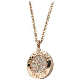 Bulgari-Collier pendentif Bulgari en or jaune, onyx et diamants.-Autre