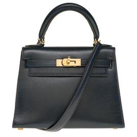 Hermès-Splendid masterpiece by Mini Kelly 20cm in leather bow navy, lined shoulder strap (short and long) in navy leather, garniture en métal doré-Navy blue