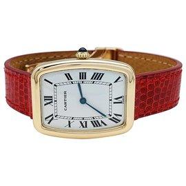 """Cartier-Montre Cartier """"Fabergé"""" en or jaune, bracelet cuir.-Autre"""