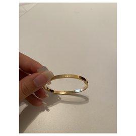 Cartier-Taille du bracelet love Cartier 16.-Doré