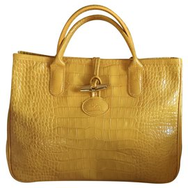 YELLOW ROSEAU BAG IN CROCO SHAPED calf leather
