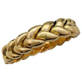Cartier-Bracelet Cartier Tresse en or jaune.-Autre
