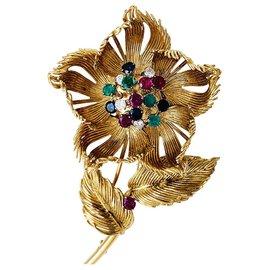 """Cartier-Broche Cartier, """"Fleur"""" en or jaune, diamants, émeraudes, rubis et saphirs.-Autre"""