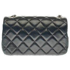 Chanel-Rare Extra Mini rectangle en cuir matelassé bleu nuit, garniture en métal argenté-Bleu Marine