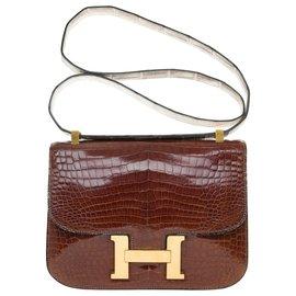 Hermès-Unique and Splendid Hermès Constance handbag in brown Porosus crocodile leather customized with a crocodile strap-Brown