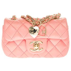 Chanel-Splendid and highly sought after Chanel Mini charms Flap bag in pink quilted leather, garniture en métal doré-Pink