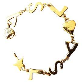 Yves Saint Laurent-YVES SAINT LAURENT. LOGO BRACELET .-Gold hardware