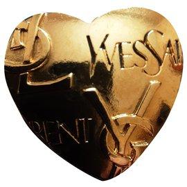 Yves Saint Laurent-YVES SAINT LAURENT.  Brooch AND pendant.-Gold hardware