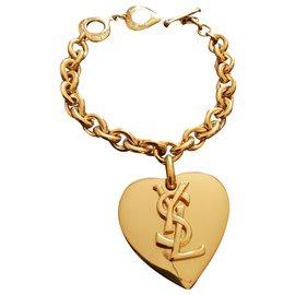 Yves Saint Laurent-YVES SAINT LAURENT.  Heart pendant bracelet.-Gold hardware