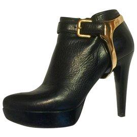 Prada-Ankle boots with golden branded stirups (removable)-Black,Gold hardware