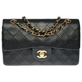 Chanel-The highly sought after Chanel Timeless bag 23cm in black quilted leather, garniture en métal doré-Black