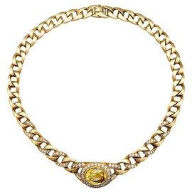 Cartier-Collier Cartier en or jaune diamants et saphir jaune.-Autre