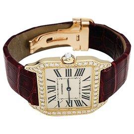 """Cartier-Montre Cartier """"Santos Dumont"""" en or et diamants sur cuir.-Autre"""