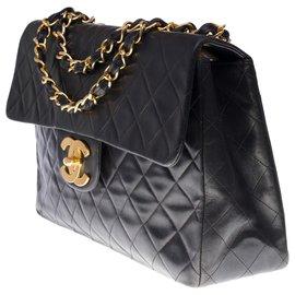 Chanel-The Majestic Chanel Maxi Jumbo handbag in black quilted caviar leather, garniture en métal doré-Black