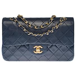 Chanel-The coveted Chanel Timeless bag 23cm with lined flap in navy blue quilted lambskin, garniture en métal doré-Navy blue