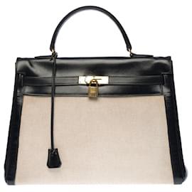 Hermès-Stunning Hermes Kelly handbag 35 inverted cm in black box leather and beige canvas, garniture en métal doré-Beige