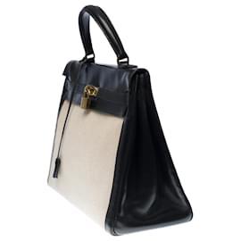 Hermès-Superbe Sac à main Hermes Kelly 35 cm retourné en cuir box noir et toile beige, garniture en métal doré-Beige