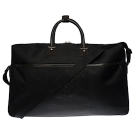 Louis Vuitton-Louis Vuitton travel bag with shoulder strap in black canvas and silver metal hardware-Black