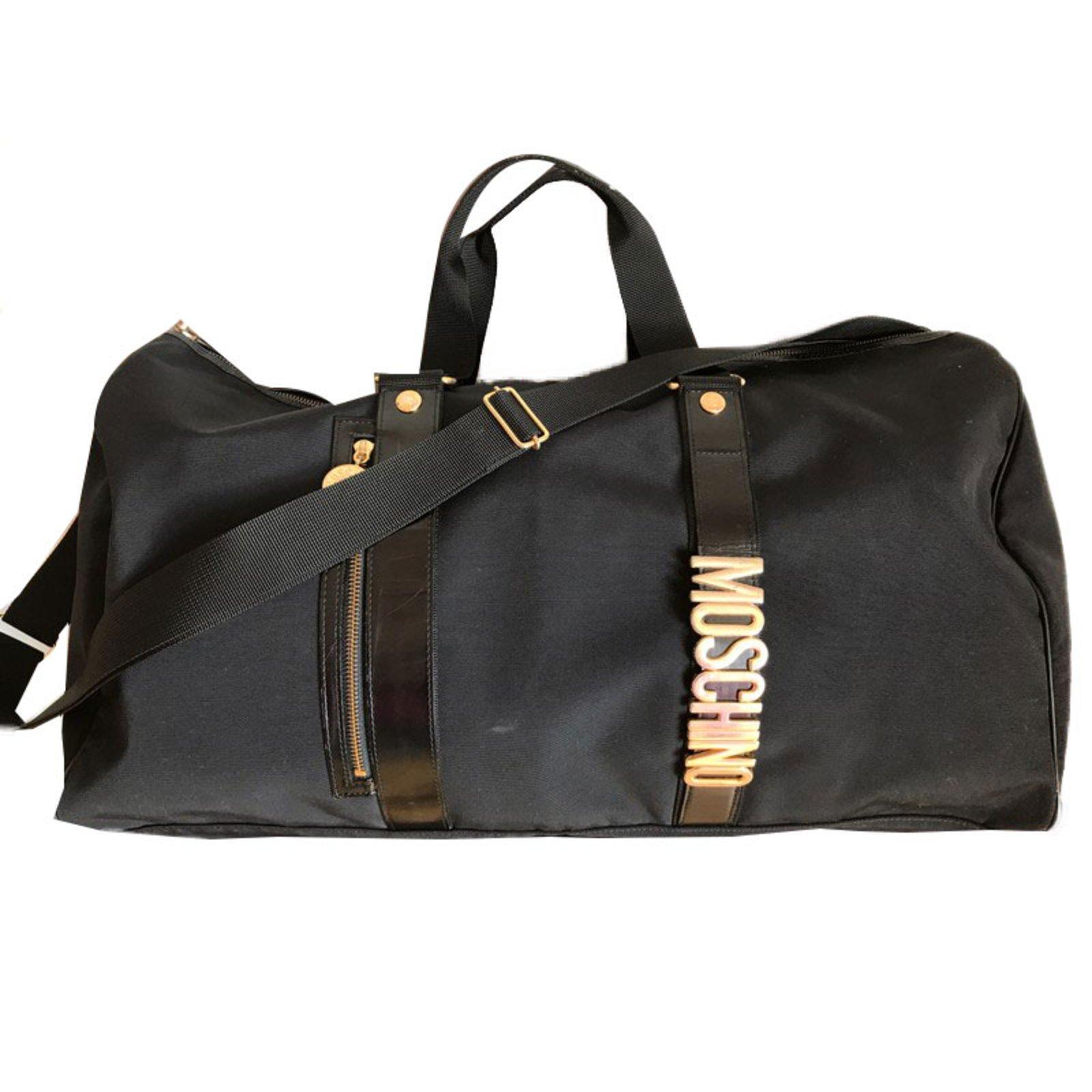 sacs de voyage moschino sac de voyage cuir m tal nylon. Black Bedroom Furniture Sets. Home Design Ideas