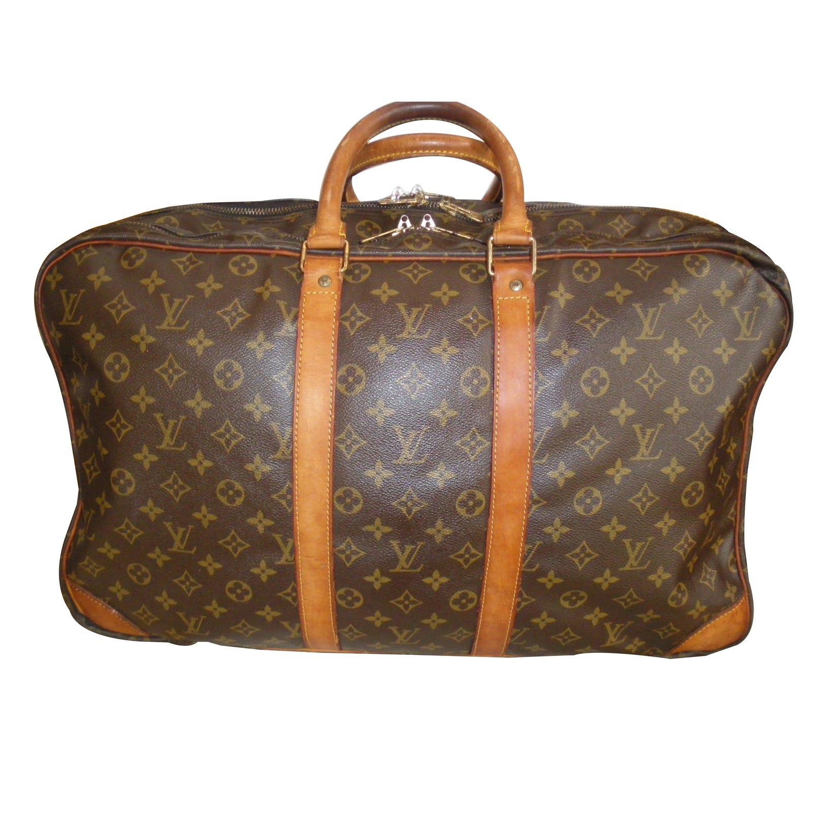sacs de voyage louis vuitton sacs de voyage toile marron joli closet. Black Bedroom Furniture Sets. Home Design Ideas