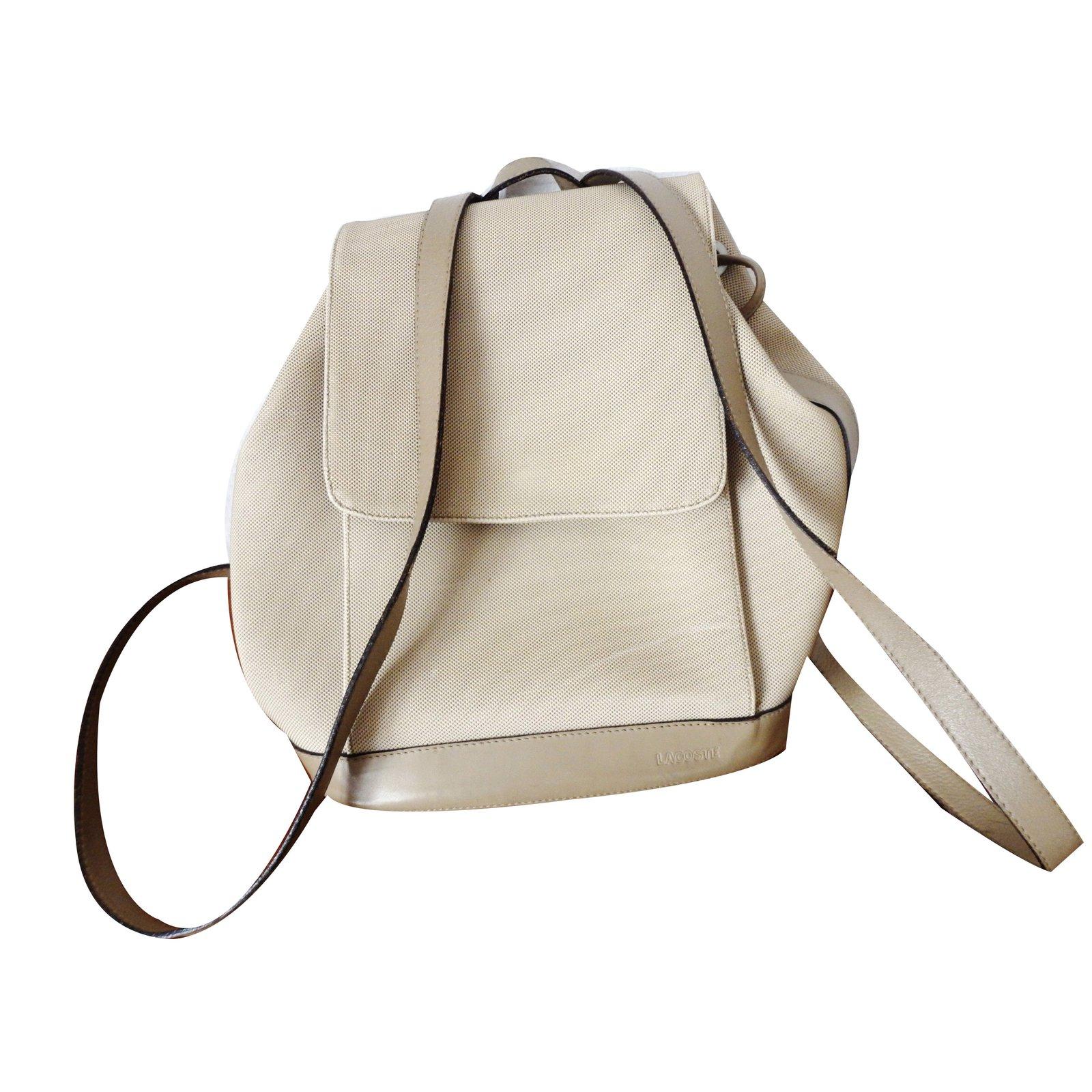 sacs dos lacoste sac dos toile et cuir toile beige ref. Black Bedroom Furniture Sets. Home Design Ideas