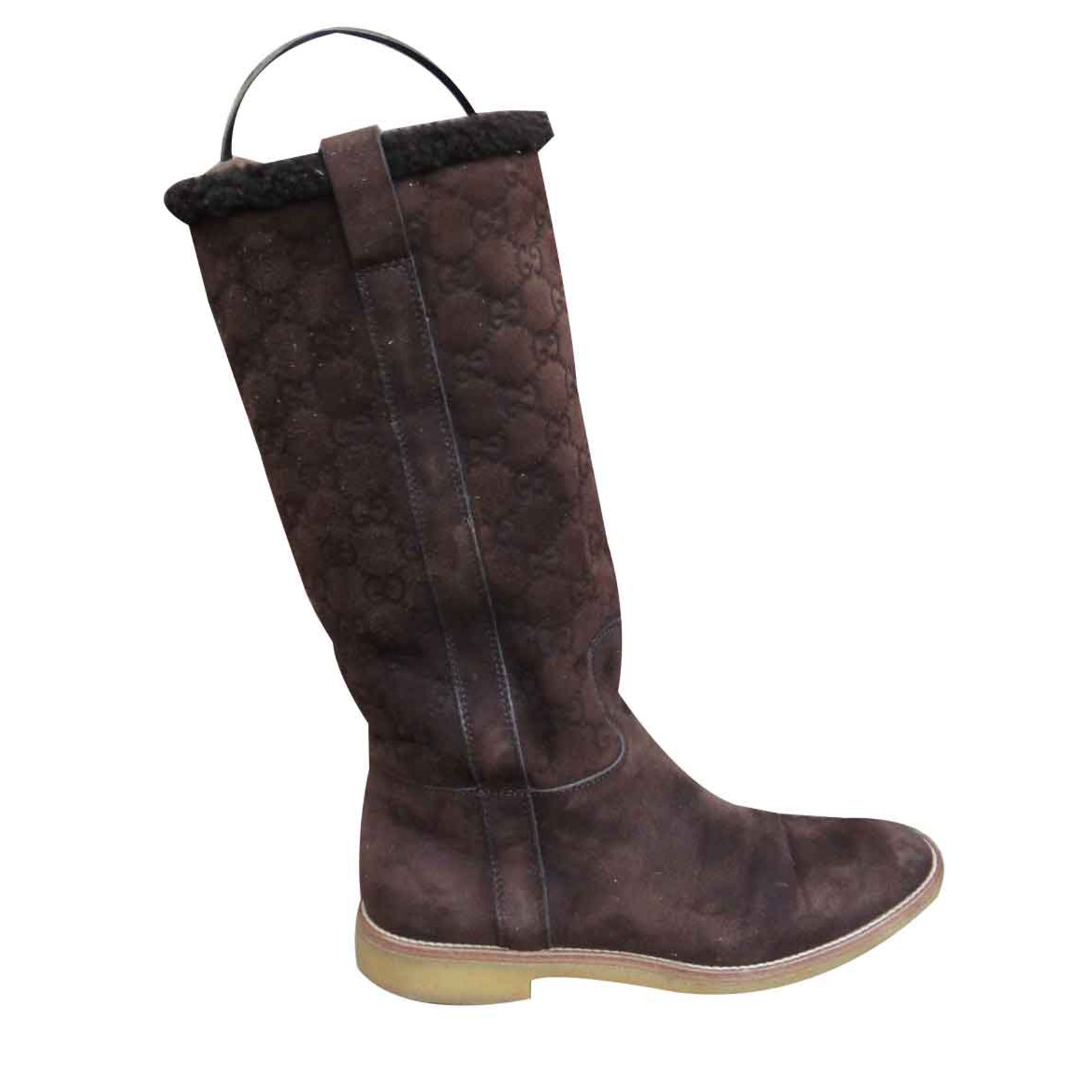 2112dc00 Gucci boots in shearling