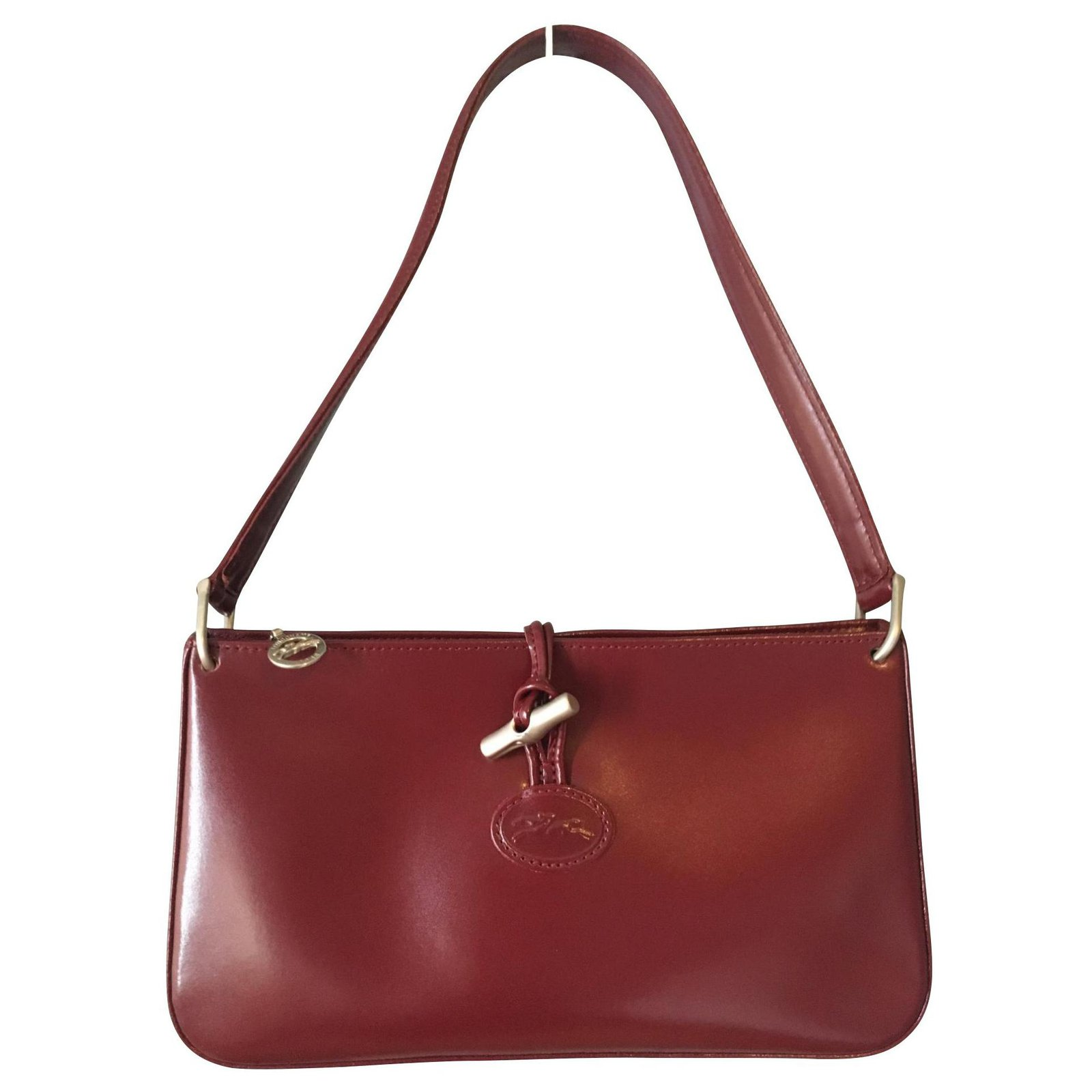 Vintage Longchamp bag, Fuseau model, cowhide leather in dark fuchsia /  burgundy tones