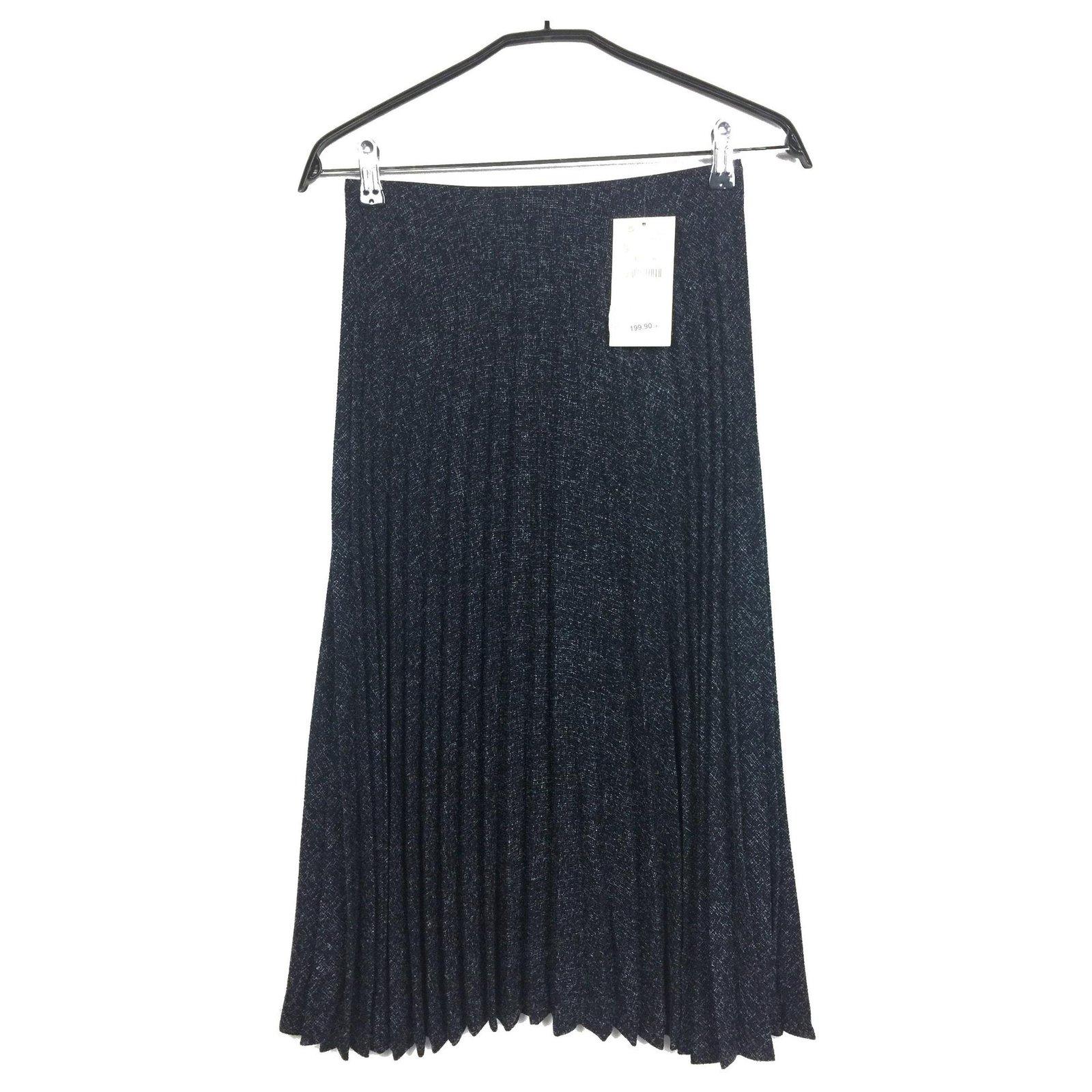 Jupe plissée en tweed midi